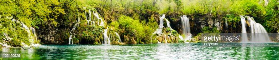 Panorama - a series of waterfalls along lake : Stock Photo