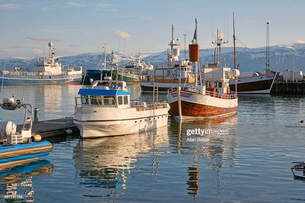 Panorama in fishing boats in Husavik harbour