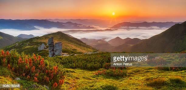 Panorama of a beautiful sunrise Panorama of a beautiful sunrise in the mountainsin the mountains
