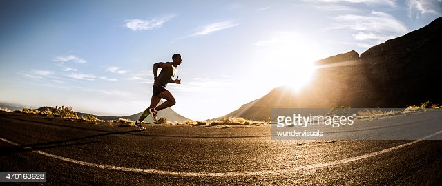 Panorama of a fit African American runner exercising outdoors