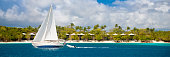 panorama of a sailboat traveling by St.John, US Virgin Islands