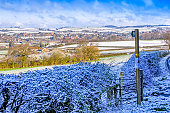 Panorama of a snow covered Dorset  town and hills, UK
