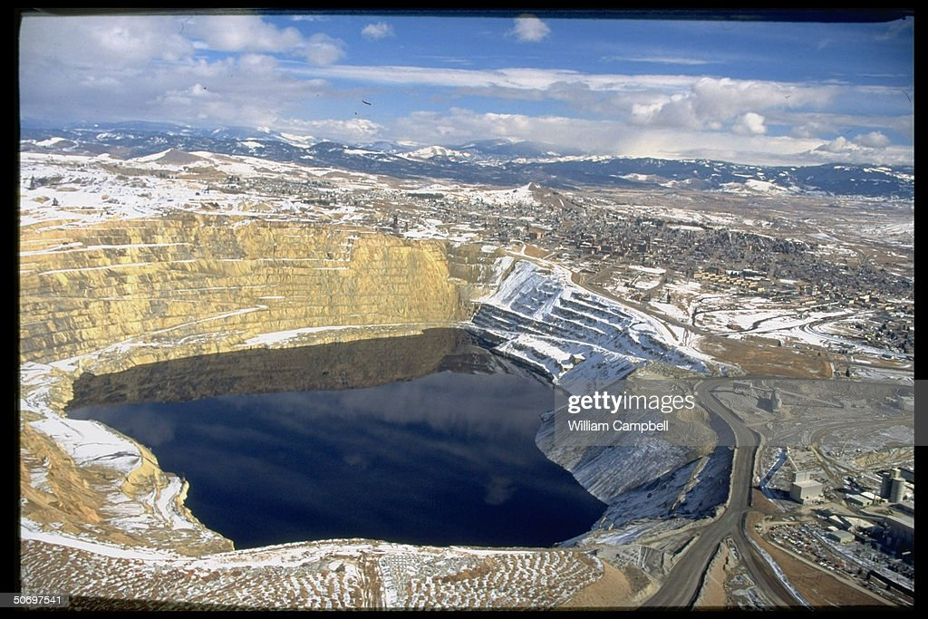 Panorama of Berkeley Pit, acid lake formed from water filling defunct strip mine reacting w. acidic mining residues from copper are posing environment threat to community.