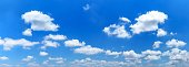 Panorama background of blue sky and white cumulus clouds at day time