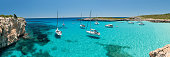 Panorama of Cala Varques Bay with Yachts,Mallorca, Spain. Nikon D810. Converted from RAW. All recognizable people and boat names have been stamped out. Please include exact sections if you see any iss