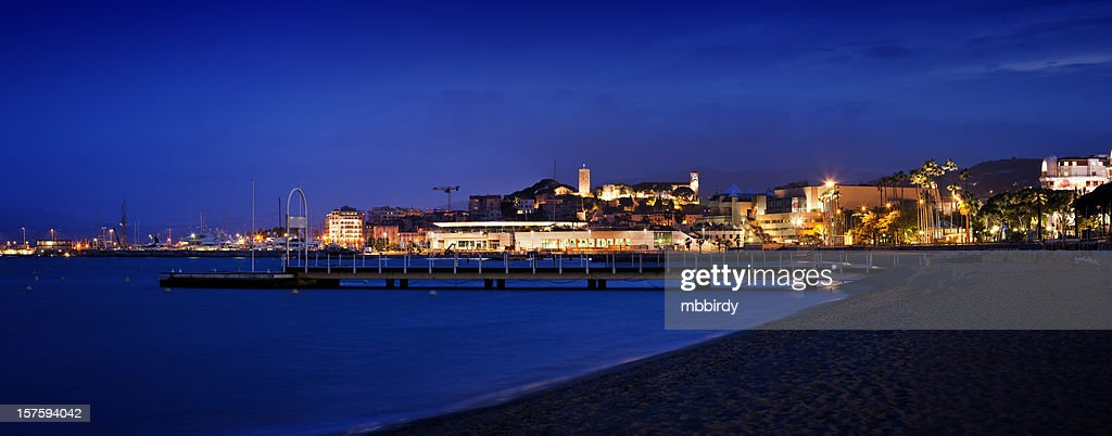 Panorama of Cannes with marine by night