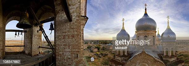 Panorama of church and bell tower in village Nikolsky, Russia