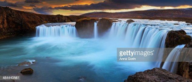 Panorama of Goðafoss waterfall at sunset