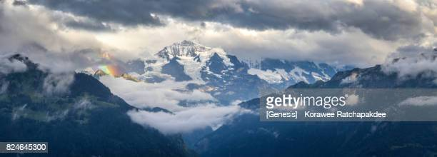 A panorama of Jungfrau mountain after raining and has a rainbow beside