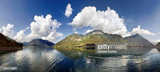 Panorama of Lake Achensee with the Rofan Mountains and bizarre clouds in the sky reflecting in the lake, Achensee, Tyrol, Austria, Europe