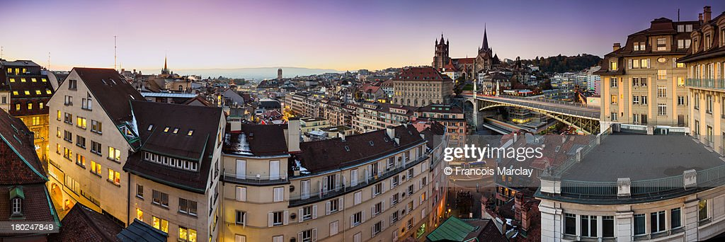 Panorama of Lausanne old town at sunset