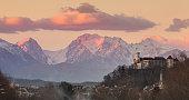 Cityscape of the Slovenian capital Ljubljana at sunset. The Karawanks mountain range in the background.