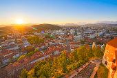 Panorama of the Slovenian capital Ljubljana at sunset. Alps mountains