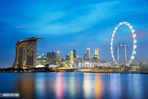 Panorama of Singapore city skyline by night : Stock Photo