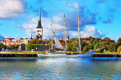 'Scenic summer panorama of pier with historical tall sailing ship in the Old Town in Tallinn, Estonia. See also:'