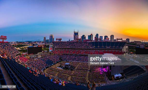 Panorama of the 2016 CMA Music Festival at Nissan Stadium with the Nashville skyline in the background on June 12 2016 in Nashville Tennessee