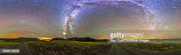 Panorama of the Milky Way and night sky at Waterton Lakes National Park, Canada.