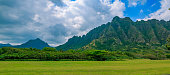 Panorama of the mountain range by Kualoa Ranch in Oahu, Hawaii. Famous movies and TV, including 'Lost' and 'Jurassic Park' were filmed here