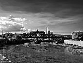 Panorama of the old industrial part of the city - black and white image.