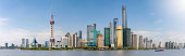 Panorama of the skyline of Shanghai, China, with the iconic buildings, during a clear, sunny day