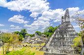 Panorama of Tikal Maya temple ruins and pyramid
