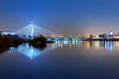 Panorama of Warsaw at night with reflection in Vistula river, Poland