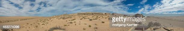 Panorama photo Buildings in the abandoned German diamond mining settlement of Kolmanskop near Luderitz Namibia