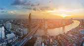 Panorama river curved Bangkok city downtown with sunset background, Thailand