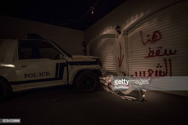 Panorama to martyr Ali Badah which riot police forces go over him with patrol cars revolution museum orginised by AlWefaq opposition society showing...
