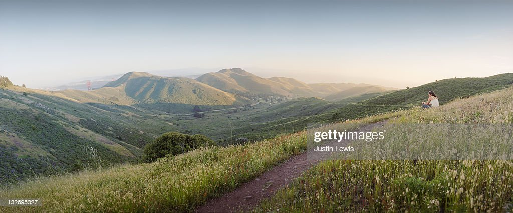 Panorama with hiker sitting on trail : Stock Photo