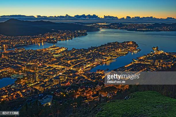 Panoramic aerial view on illuminated Bergen City at dusk, Norway