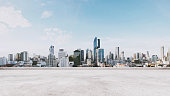 Panoramic city view with empty concrete floor