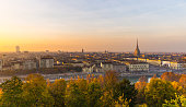 Sunset on Torino (Turin), Piedmont, Italy. Panoramic cityscape from above with Mole Antonelliana towering on the city and romatic colorful sky. Summer adventures in italian historical towns.