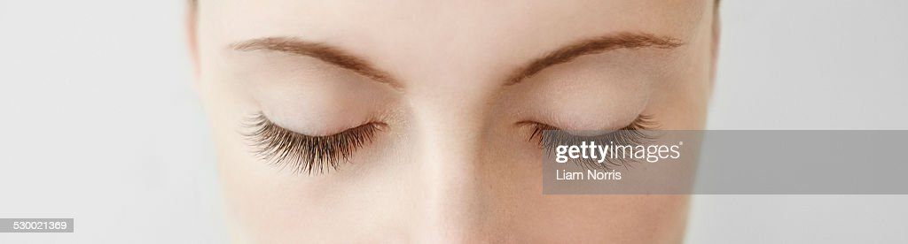Panoramic close up of mid adult womans closed eyes