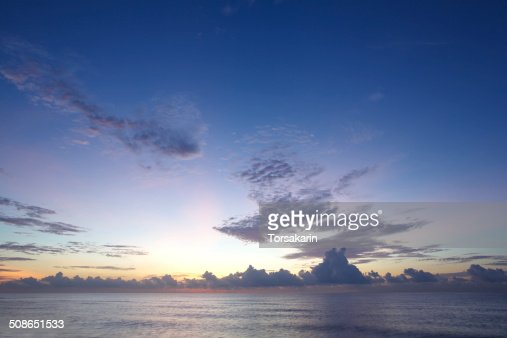 Panoramic dramatic tropical sunset sky and sea at dusk : Stock Photo