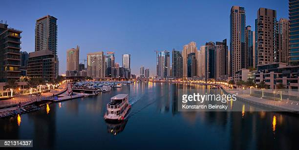 Panoramic Dubai Marina with boat at dawn