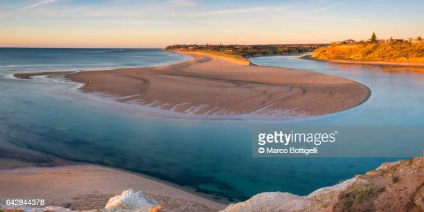 Panoramic high angle view of the Onkaparinga river mouth at sunset. South Australia, Australia.