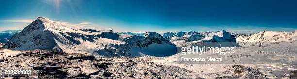 Panoramic image of snow covered mountains, Laax, Swiss Alps, Switzerland