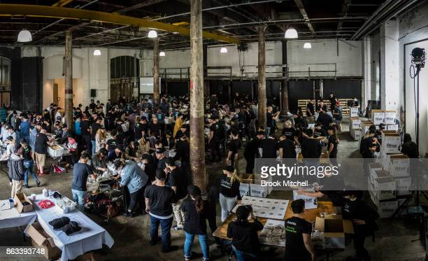 A panoramic image of volunteers in action during Zambrero's meal packing day on October 20 2017 in Sydney Australia More than 1700 volunteers across...