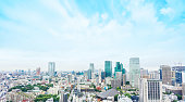 Business and culture concept - panoramic modern city skyline bird eye aerial view from tokyo tower under dramatic sunny and morning blue cloudy sky in Tokyo, Japan