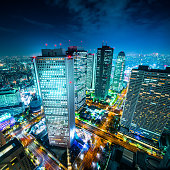 Asia Business concept for real estate and corporate construction - panoramic modern city skyline aerial night view of Shinjuku area under twilight sky in Tokyo, Japan