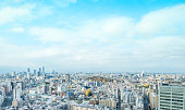 Asia business concept for real estate and corporate construction - panoramic modern city skyline aerial view of bunkyo under blue sky and cloud, tokyo, Japan