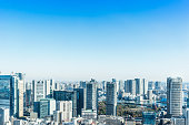 Asia Business concept for real estate and corporate construction - panoramic modern city skyline bird eye aerial view near tokyo tower under bright sun and vivid blue sky in Tokyo, Japan