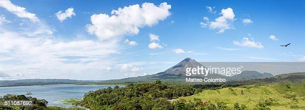 Panoramic of Arenal volcano and lake with blue sky, Costa Rica
