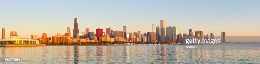 Panoramic of golden sunrise across Chicago skyline