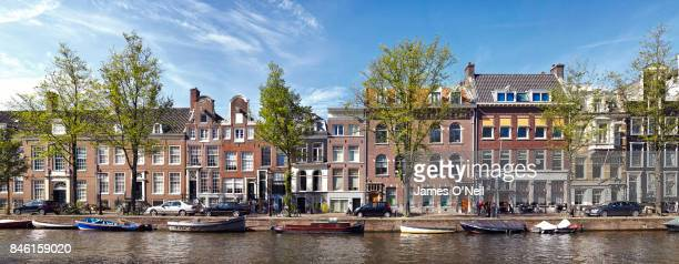 Panoramic of houses along a canal in Amsterdam, Netherlands