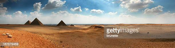 Panoramic of the Giza Pyramids on a cloudy yet sunny day