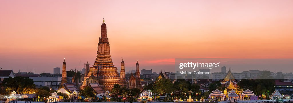 Panoramic of Wat Arun temple at sunset, Bangkok, Thailand