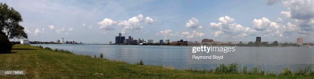 Panoramic partial views of the Windsor, Canada and Detroit Skylines as photographed from Belle Isle State Park on July 18, 2014 in Detroit, Michigan.