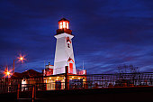 Panoramic photo of a lighthouse at night